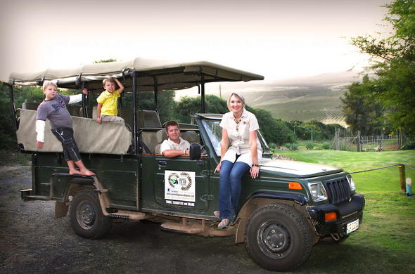Family game drive vehicle in Addo Dung Beetle Guest Farm.