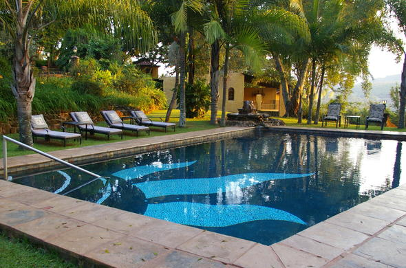 Relax by the swimming pool at Bohms Zeederberg Country House.