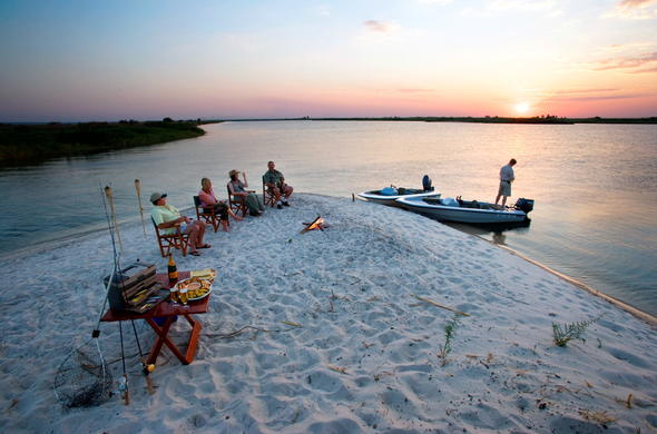Sundowners at Ntwala Island Lodge. Caprivi