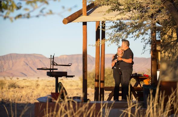 Relax on the Desert Camp patio with drinks.
