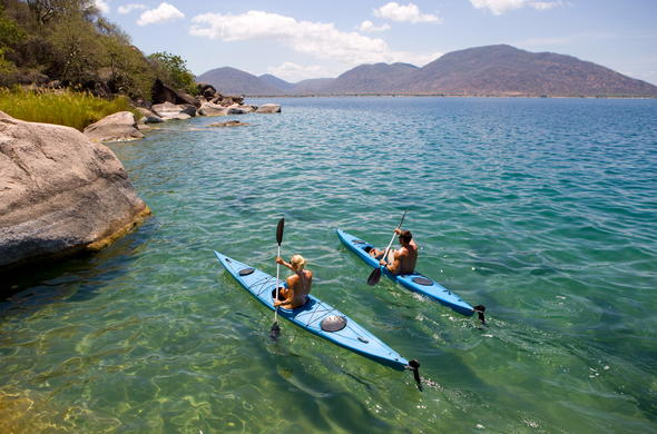Canoeing on Cape Maclear, off Domwe Island. Lake Malawi