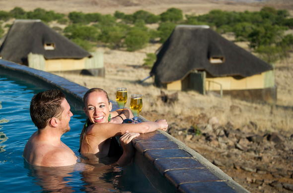 Relax in the pool at Doro Nawas Camp overlooking the Aba-Huab River Valley.