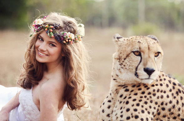 Bride poses with a Cheetah at Emdoneni Lodge and Game Farm.