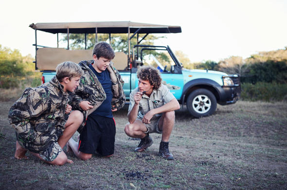 Children on safari with an expert ranger.