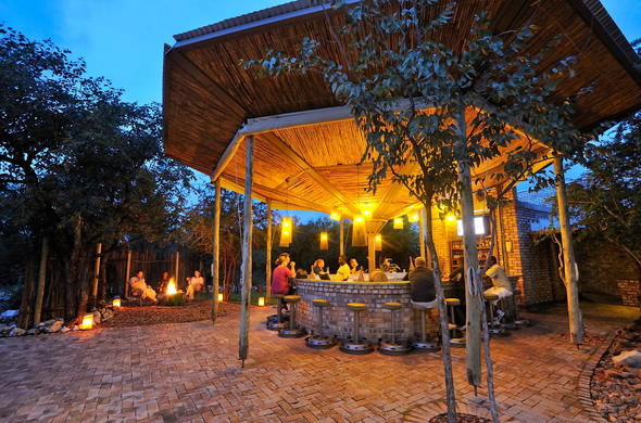 Unwind at the Etosha Village bar or around the campfire.