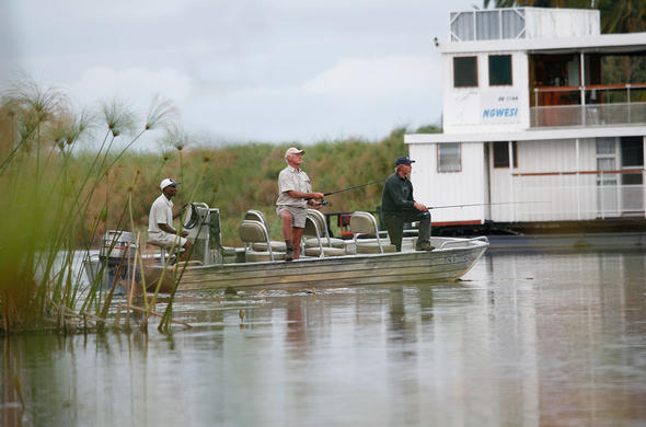 Fishing from Ngwesi Houseboat. Okavango