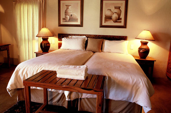Twin bedroom accommodation is offered at Hans Merensky Hotel & Spa.