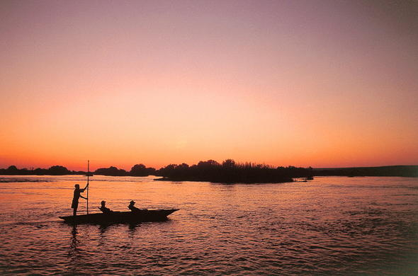Mokoro trip at sunset on the Zambezi river.