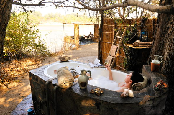 Luxuriate in an outdoor bubble bath at Kaingo Camp.