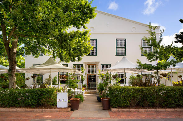 Exterior of the contemporary Balko Restaurant at Alphen Hotel.