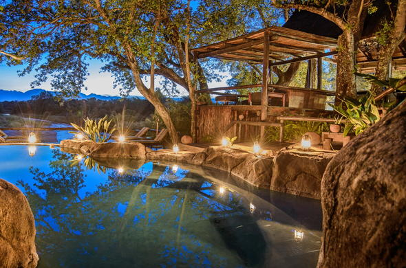 The stunning Kuname Lodge pool by night.