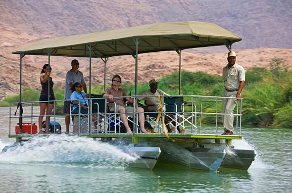 Explore the Kunene River on a boat safari.