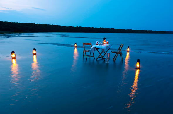 Romantic dinner for two setting at Makakatana Bay Lodge.