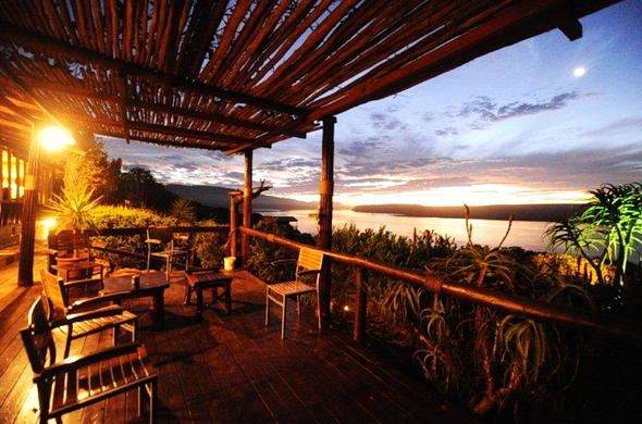 Watch the sunset from the deck at Mudlark Riverfront Lodge.