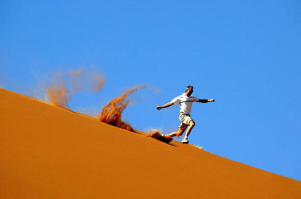 Running down a sand dune in Namibia.