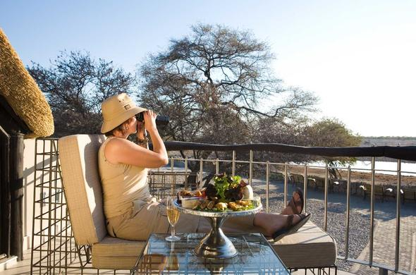 Guest enjoying scenic views of Etosha National Park.