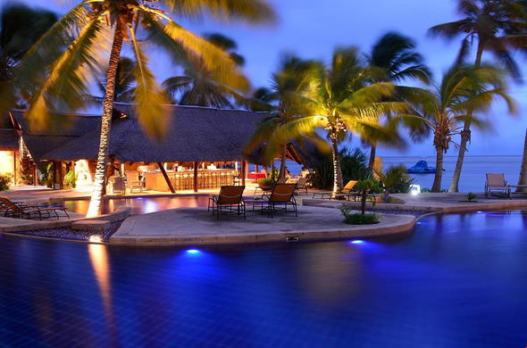 The stunning pool area of Pestana Bazaruto Lodge by night.