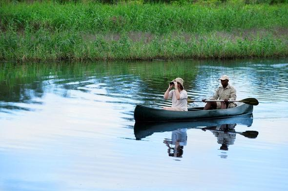 Guest on a canoeing safari in the Phinda Reserve.