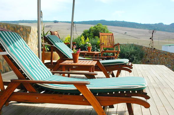 Relax on the sun loungers by the swimming pool at Rouxwil Country House.