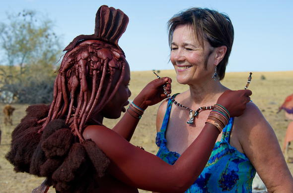 Receiving a tribal necklace from a Himba woman.