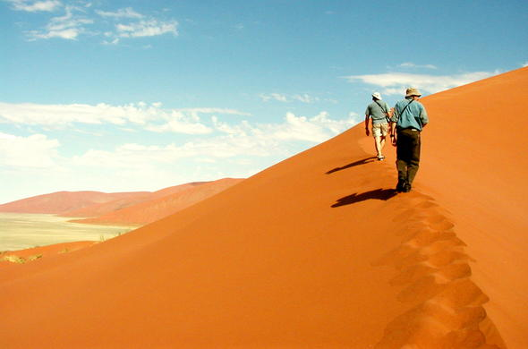 Climbing the desert dunes in Sossusvlei.