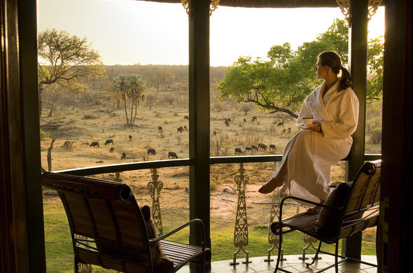 Indulge in scenic views from the balcony of Stanley and Livingstone Safari Lodge.