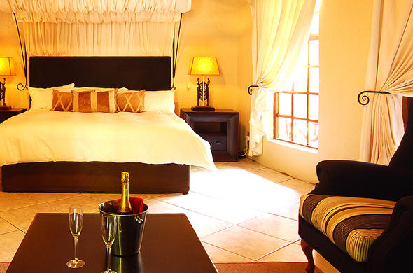 Sip champagne in the Umbhaba Lodge accommodation.