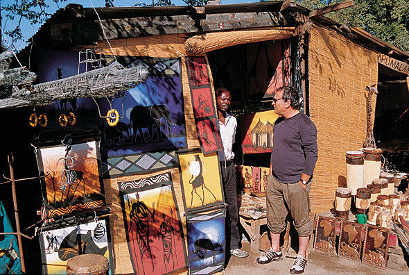 Craft shopping in Livingstone, Victoria Falls. Images of Africa.