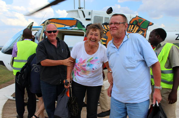 Happy guests returning from a Helicopter flight over the Victoria Falls.