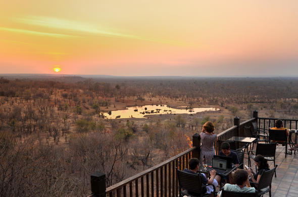 Guests on deck overlooking the waterhole.