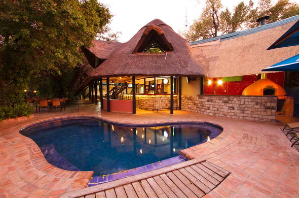Exterior and pool area of the Victoria Falls Waterfront.