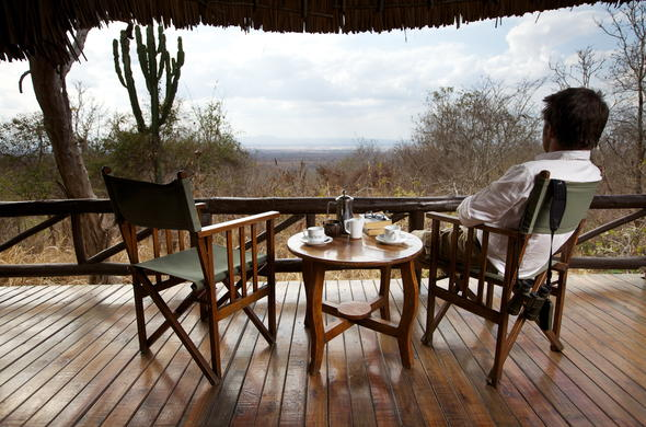 Coffee and scenic views on the private patio at Vuma Hills Tented Camp.