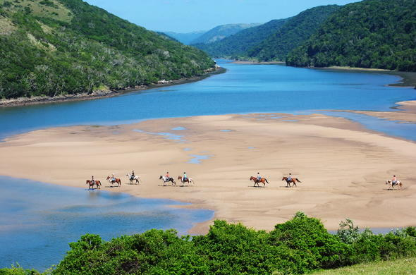 Wild Coast horseback adventures in KwaZulu-Natal Guide, South Africa.
