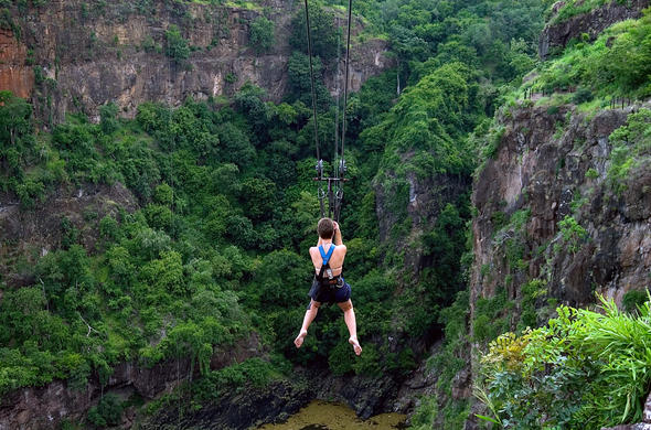 A guest experiencing the adrenaline rush of Zip Lining.