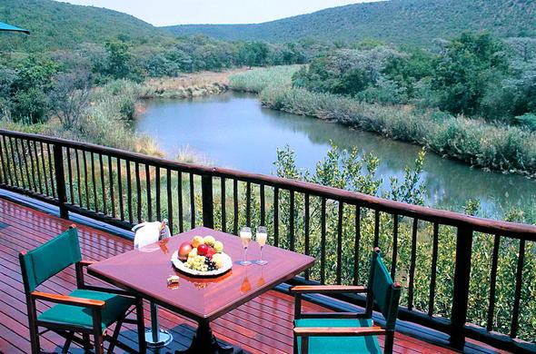 Enjoy fresh fruit and champagne over scenic views at Witwater Safari Lodge & Spa.