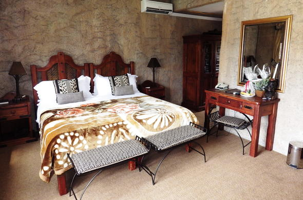 Comfortable bedroom at Zebra Country Lodge.